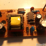 A wall wart power supply  stripped of it's casing. 220V~ to 5V DC